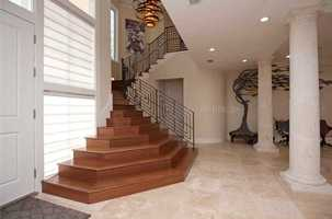 The cherry wood staircase leads to the second floor.