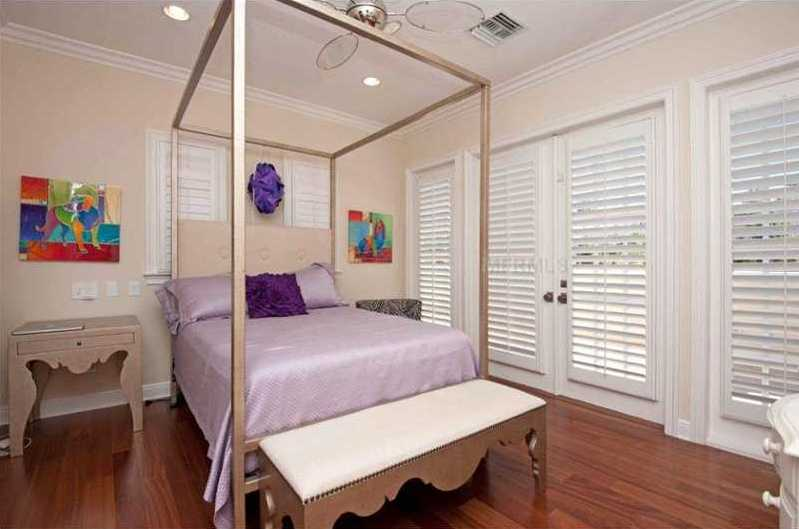 Another spacious guest suite includes a balcony.