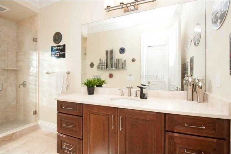 Beautiful, step-in tile shower in the guest bathroom.