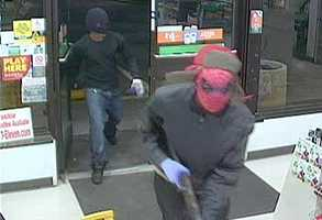 Surveillance video shows the two men who robbed a 7-Eleven in Altamonte Springs. If you have any information about this crime, call Altamonte Springs police.