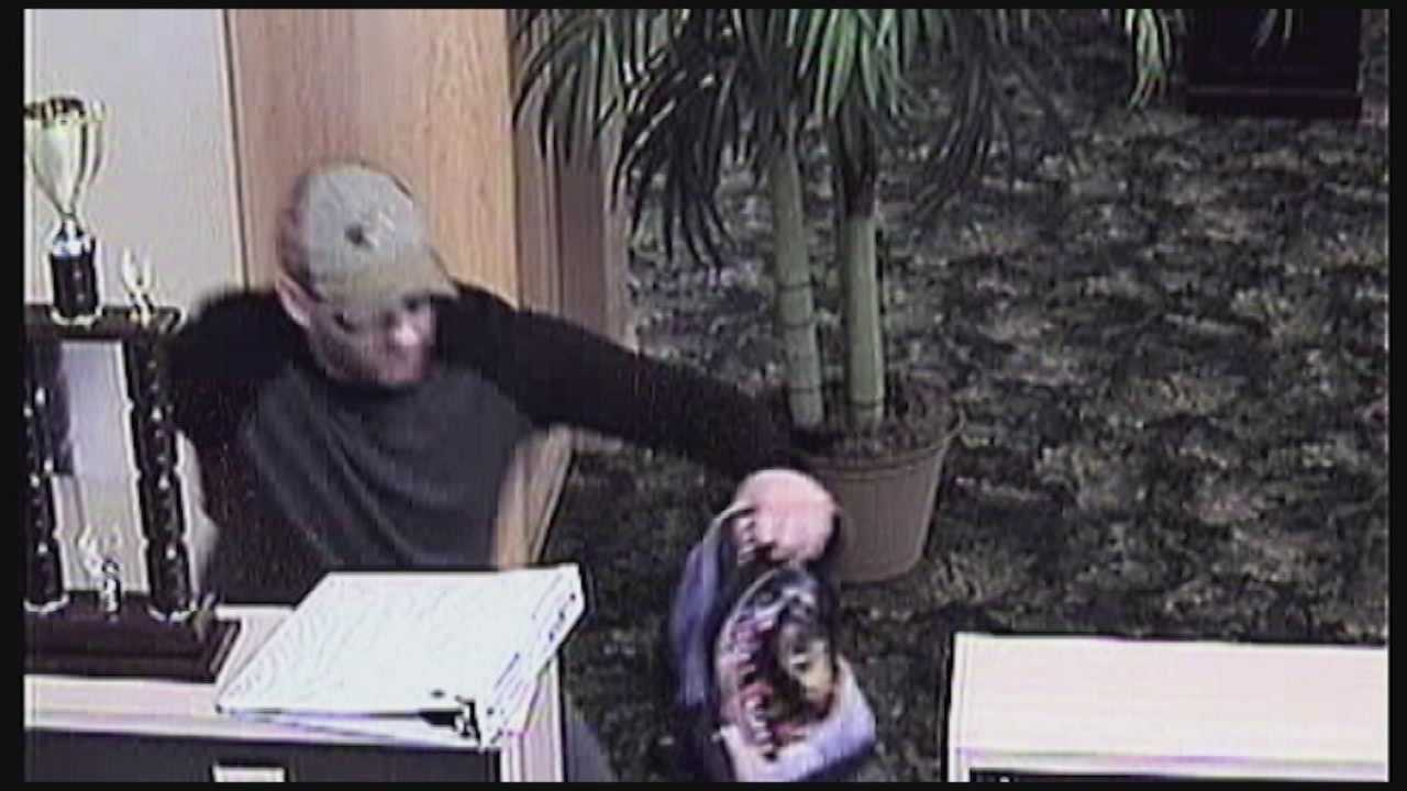 A bank robber manhandled a bank employee during a heist at a Titusville bank Thursday.
