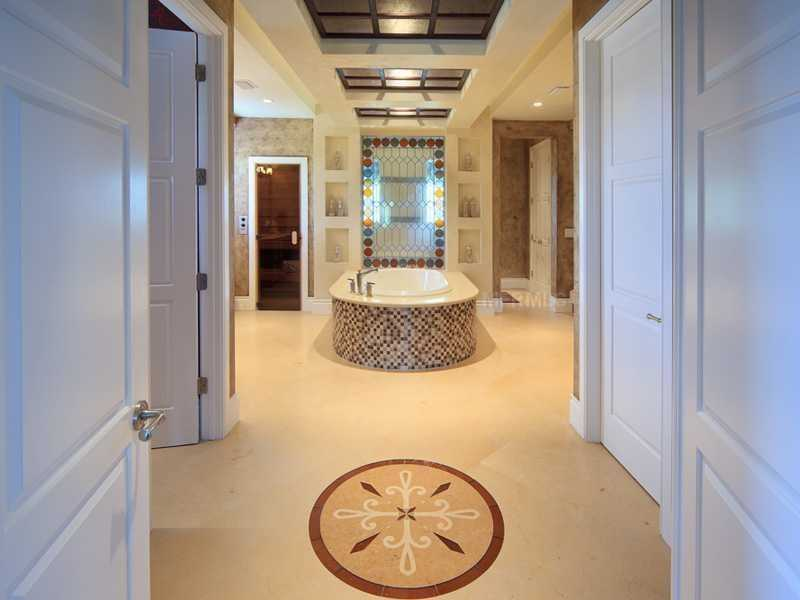 Master bathroom features a free-standing tub.