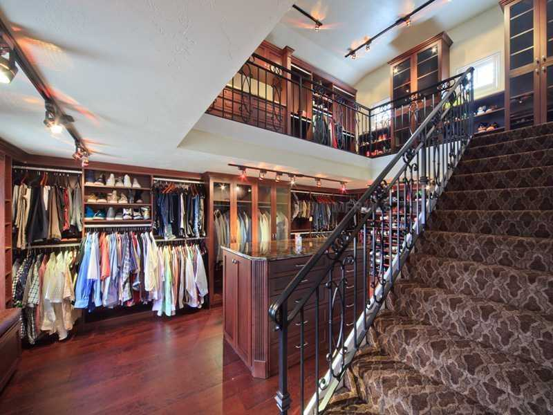 A two-story closet and dressing room.