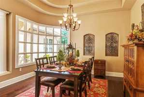 The beautiful dining area boasts a wide window to allow plenty of sunlight.