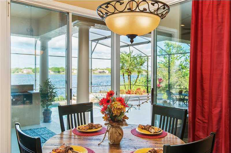 The breakfast nook also looks out over the pool and lake.
