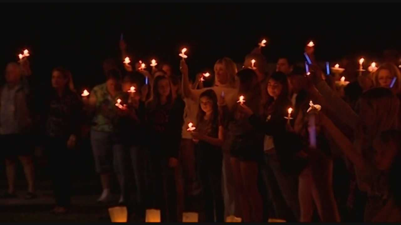 Hundreds of people gathered in Windermere Friday night for a candlelight vigil honoring fallen police officer Robert German.
