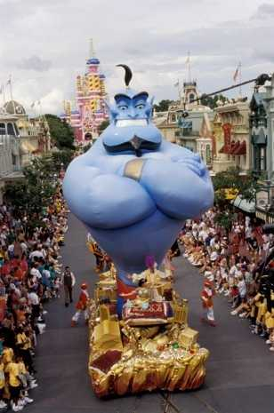 "Genie from ""Aladdin"" cruised the parade on his treasure-themed float joined by Princess Jasmine and Aladdin."