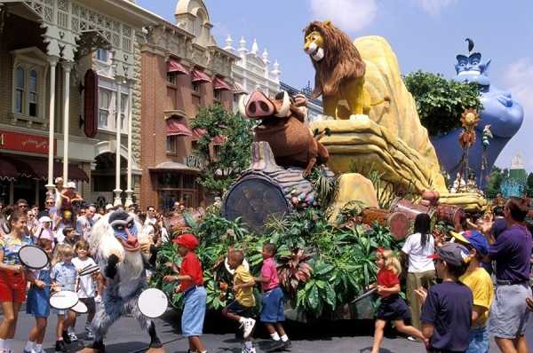 """The Lion King"" also had its own float, which featured Simba, Pumbaa and other characters from the film. Rafiki also walked along the parade path and encouraged young guests to participate in the fun by beating drums."