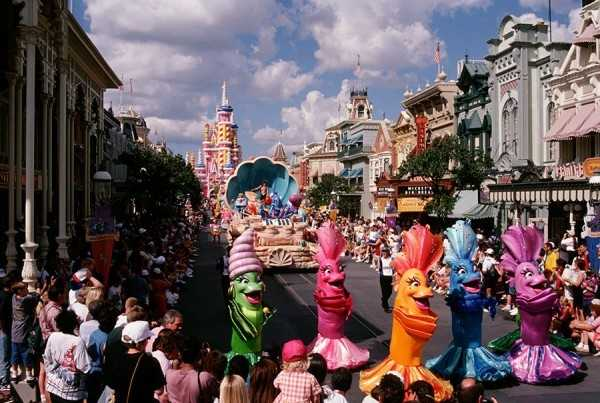 "Ariel and other characters from ""The Little Mermaid"" appeared in an impressive seashell float, surrounded by dancing fish friends, who would periodically pause and encourage guests to celebrate by dancing along."