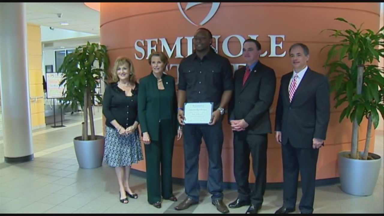 A Seminole County college student received a scholarship for helping to rescue three children after a mother drove her van into the ocean.