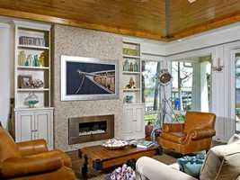 The family room features a modernized fireplace.