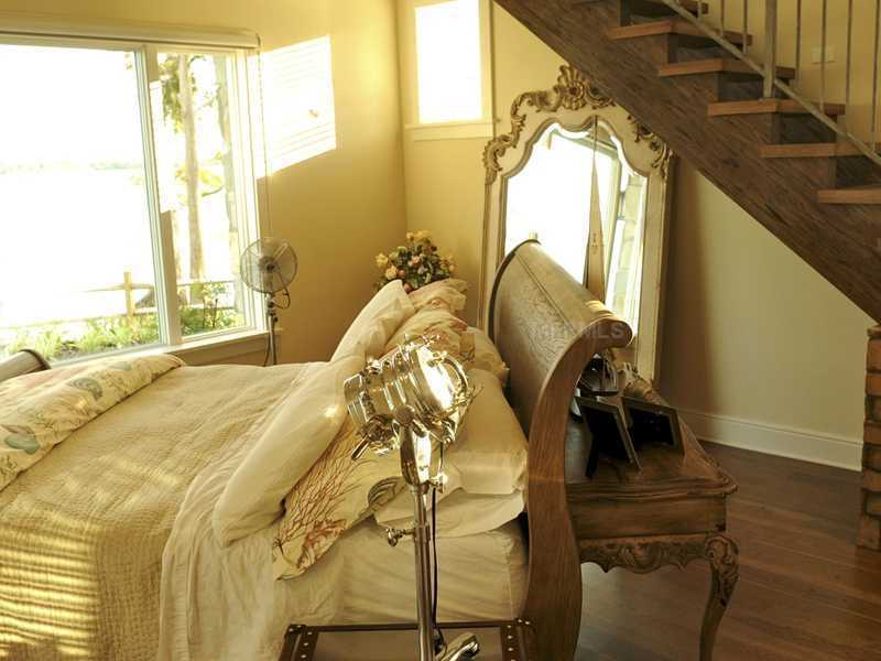 Unlike the rest of the home, this bedroom features an antiqued, seaside decor.