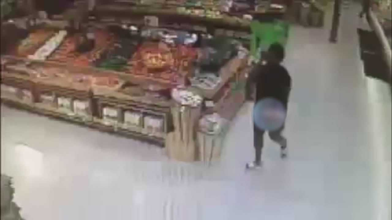 Authorities are looking for a woman who is accused of stealing two boxes of wine from a supermarket, and she wasn't wearing pants.