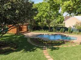 The expansive backyard features pool and cabana.