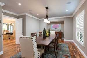 Steps from the breakfast nook, behind beautiful double doors, is the formal dining room.