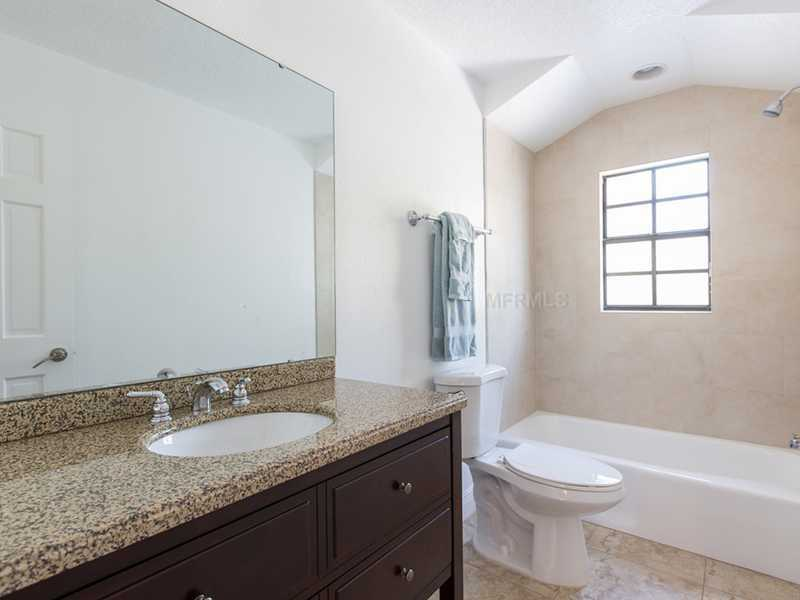 The tub in this bathroom is not free-standing, but is still elongated.