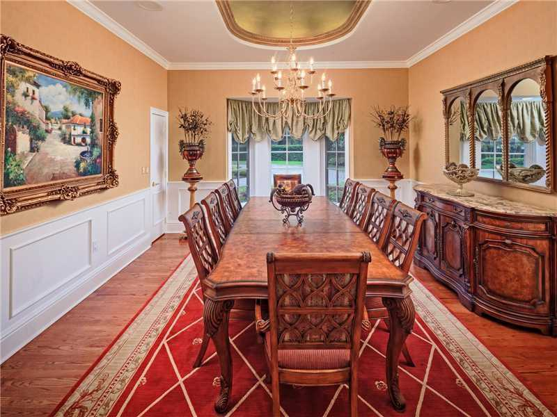 The dining room has domed ceilings and inlaid flooring.