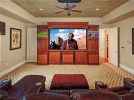 A custom unit was made for three flat screen TV's and surround sound.
