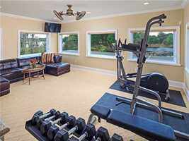 The home gym has a view of the lake.