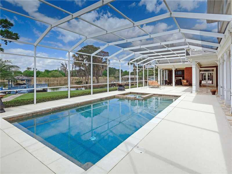 The screened-in porch features a pool.
