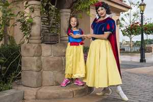 Modern Family actress Aubrey Anderson-Emmons, 6, posed with Snow White at Epcot. The star, who portrays Lily, visited the park on April 21, 2014.