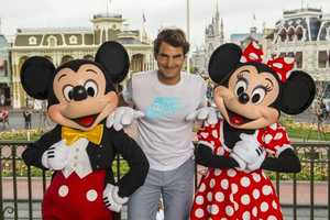 Tennis legend Roger Federer visited with Mickey and Minnie Mouse at the Magic Kingdom on March 17, 2014. The Swiss-born Federer holds the men's world record for most Grand Slam tournaments won, 17, and has spent 302 weeks as the world's number-one ranked male tennis player.