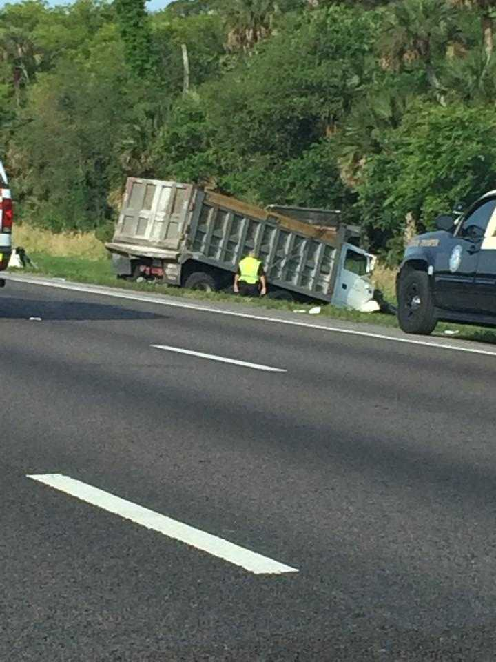 A woman died early Monday after a crash involving a dump truck closed Interstate 4 westbound.