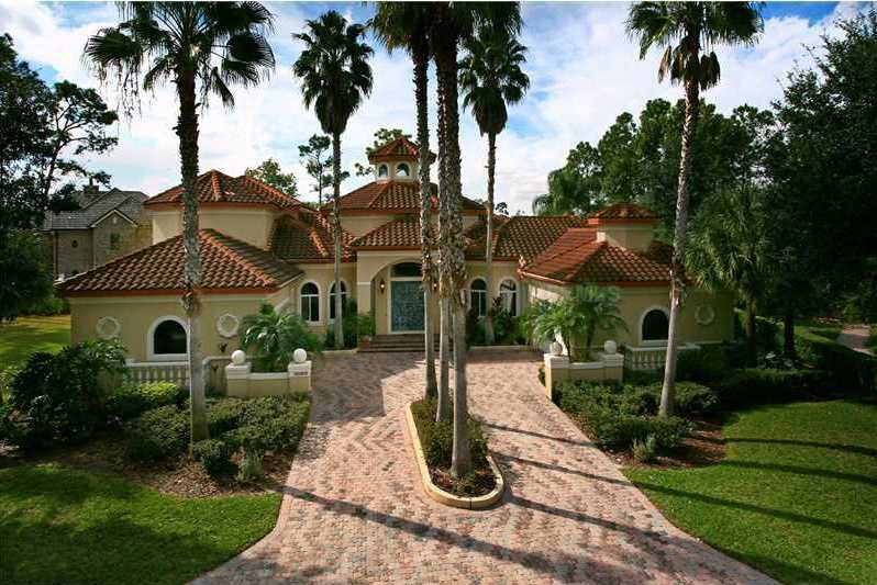 Take a peek inside this four bedroom, five bathroom country club estate in Orlando.