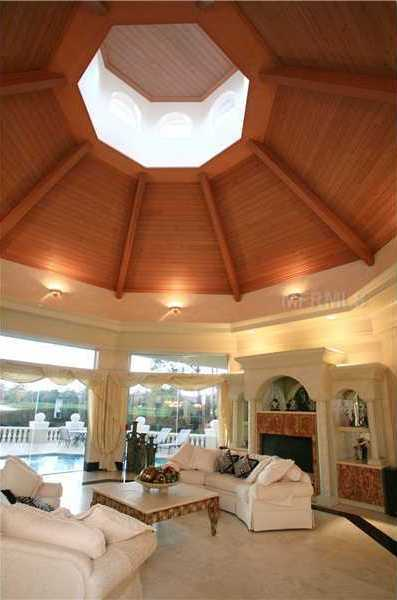 Plus, this room has a wood paneled dome ceiling with a sunlight.