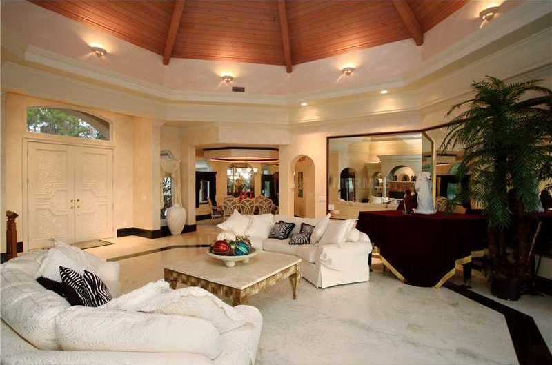 The front doors open right into formal living room.