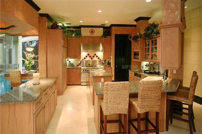 The kitchen features a dining bar for casual dining.