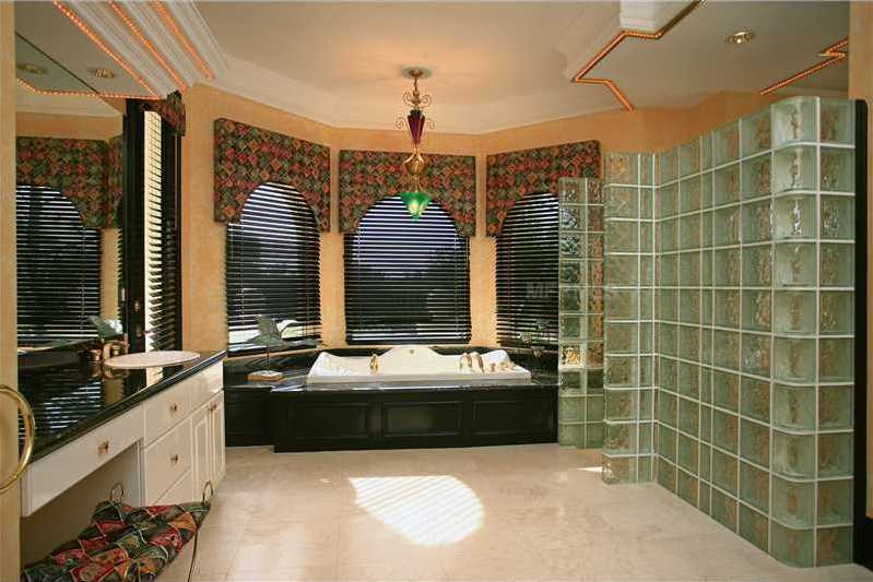 Master bathroom features a generous spa tub and widened vanity.