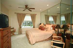 The master bedroom features private access to the patio area.