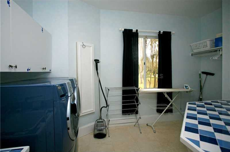 Spacious laundry room.