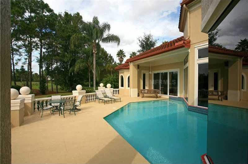 The pool area is perfect for entertaining outdoors.