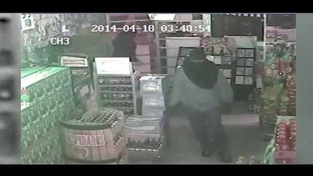 Surveillance video shows a group of burglars cleaning out an Orange County liquor store.