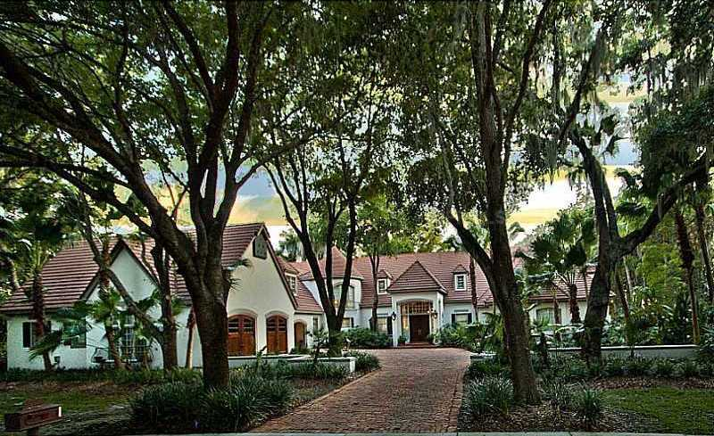 The 7,617 square foot mansion has an open floor plan, vaulted wooden ceilings, a home office and a prime location.