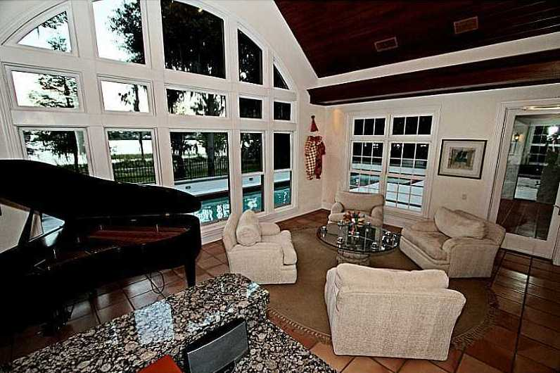 This room expands into a sun room and overlooks the pool.
