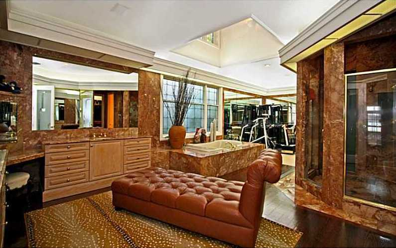 The master bathroom is large enough for a chaise lounge and gym equipment.