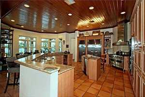 The kitchen has Terracotta floors and opens into the family room.