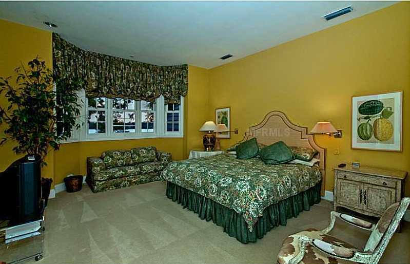 This guest suite has a large bay window that overlooks the lake.