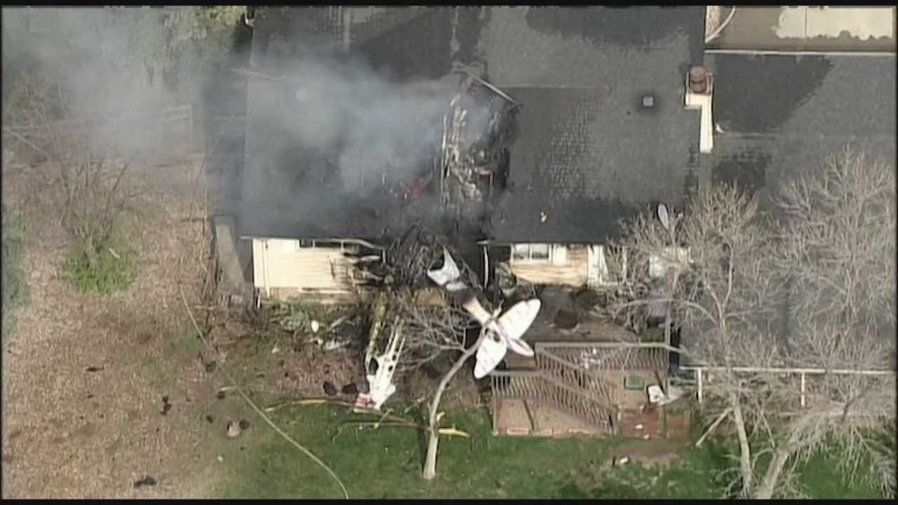 A pilot parachuted to safety moments before his plane plunged into a Colorado home.
