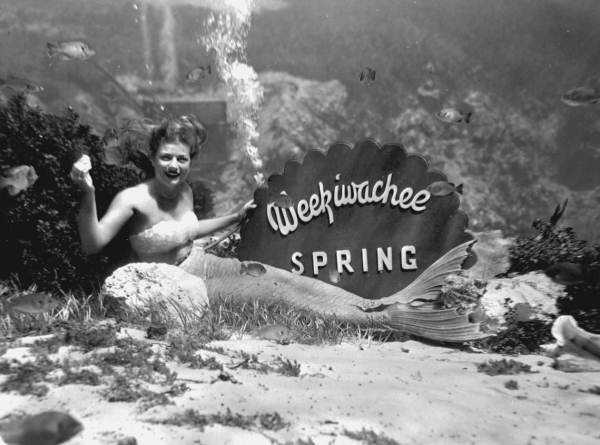 Nancy Tribble, in 1947, posed with underwater sign at Weeki Wachee Springs.