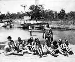Newton Perry hired and trained all mermaids at the park. Here he is with some of them in 1948.