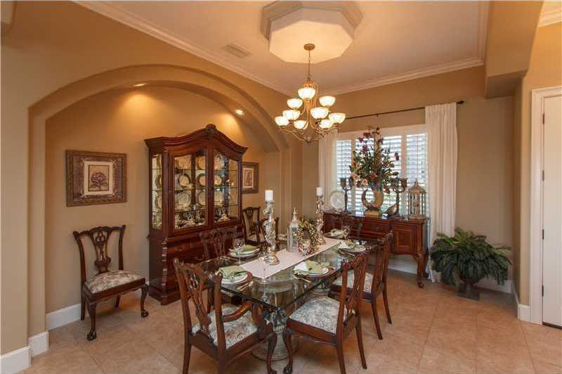 The formal dining room is immediately to the right of the entrance and across from the living room.