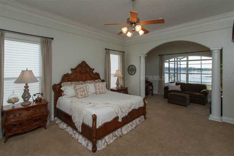This home has three master suites -- this suite is downstairs and includes a spacious sitting area.