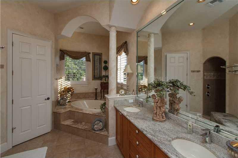Luxurious master bathroom includes a spa tub.