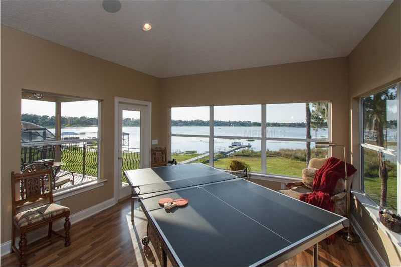 """This open floor plan encourages tranquility and socializing. So this """"sun room"""" is currently also used for ping pong."""