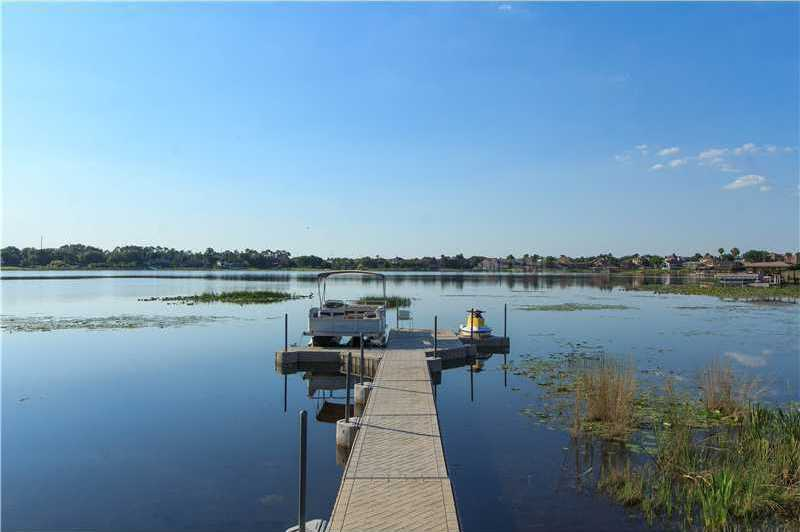 The floating boat dock is always the perfect level in the lake.
