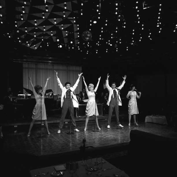 """In June of 1981, guests were able to enjoy the """"Broadway on Top"""" dinner show during their meal. The show ran until September of 1993. This photo shows the performers from a show in January of 1985."""